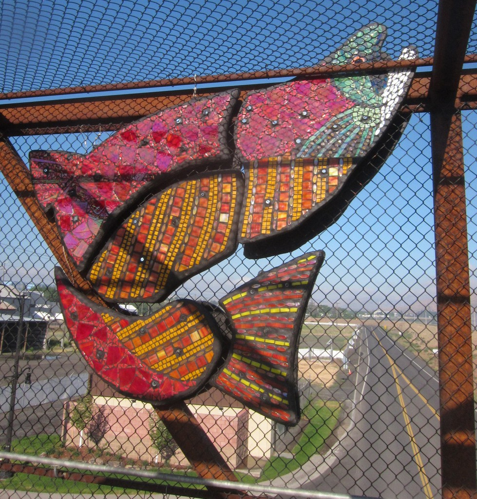 2014 Juror's Choice: Giulio Menossi. Melissa Cole, Confluence (of the Snake and Clearwater Rivers), 2013, Concrete, stained, fused glass, recycled glass tile, and epoxy grout, concrete and Wedi board. Installation Location: Lewiston, ID