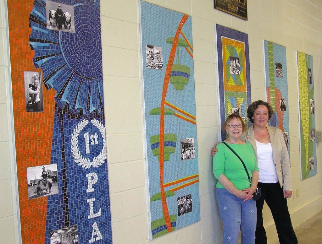 SAMA members Brenda Leslie (left) and Tina Murano in front of their five-panel mosaic project at the 2013 Kansas State Fair.