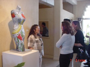 "Artist with ""Eve"".  mannequin, stained glass"