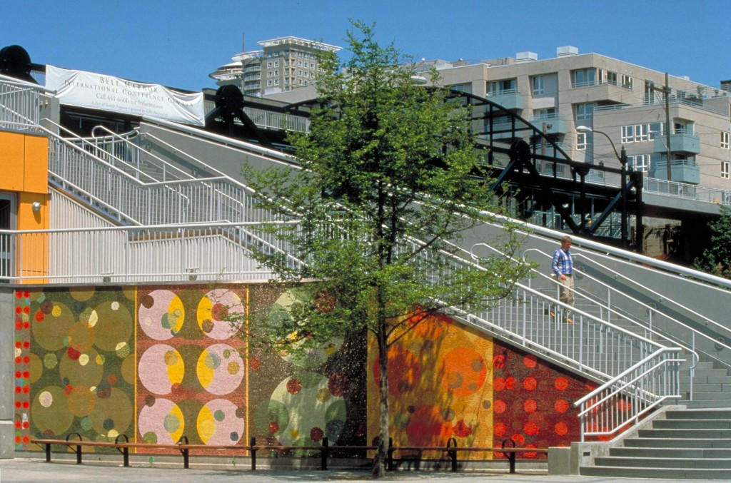 """Danza del Cerchio"" by Ann Gardner, 1996, smalti.  Pier 66, (aka Bell Str. Pier) exterior west wall of staircase"
